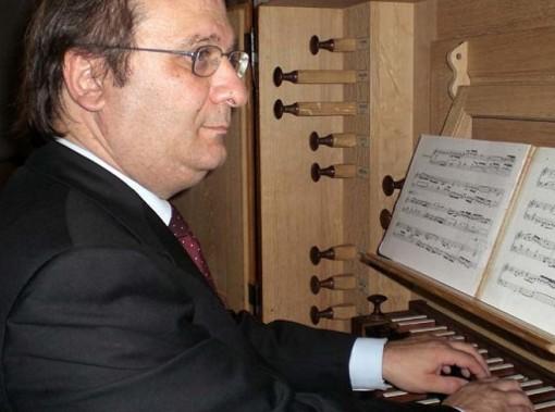 Ennio Cominetti, organista e compositore varennese.