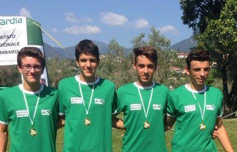 """Simone, Davide, Riccardo Elia e Nicolas Castelnovo, vincitori del titolo regionale con il """"quattro senza""""."""